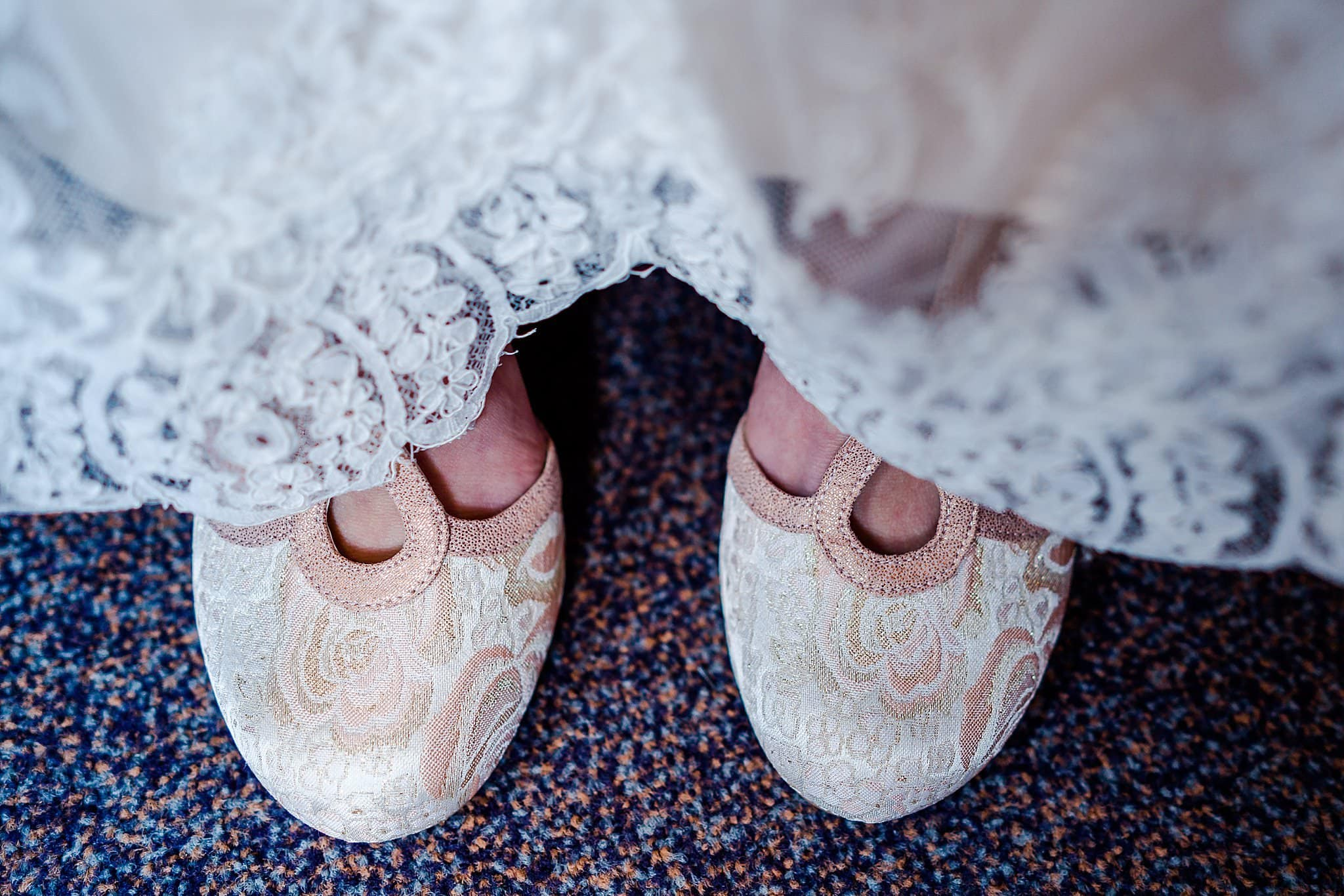 Bride's shoes poking out from under dress