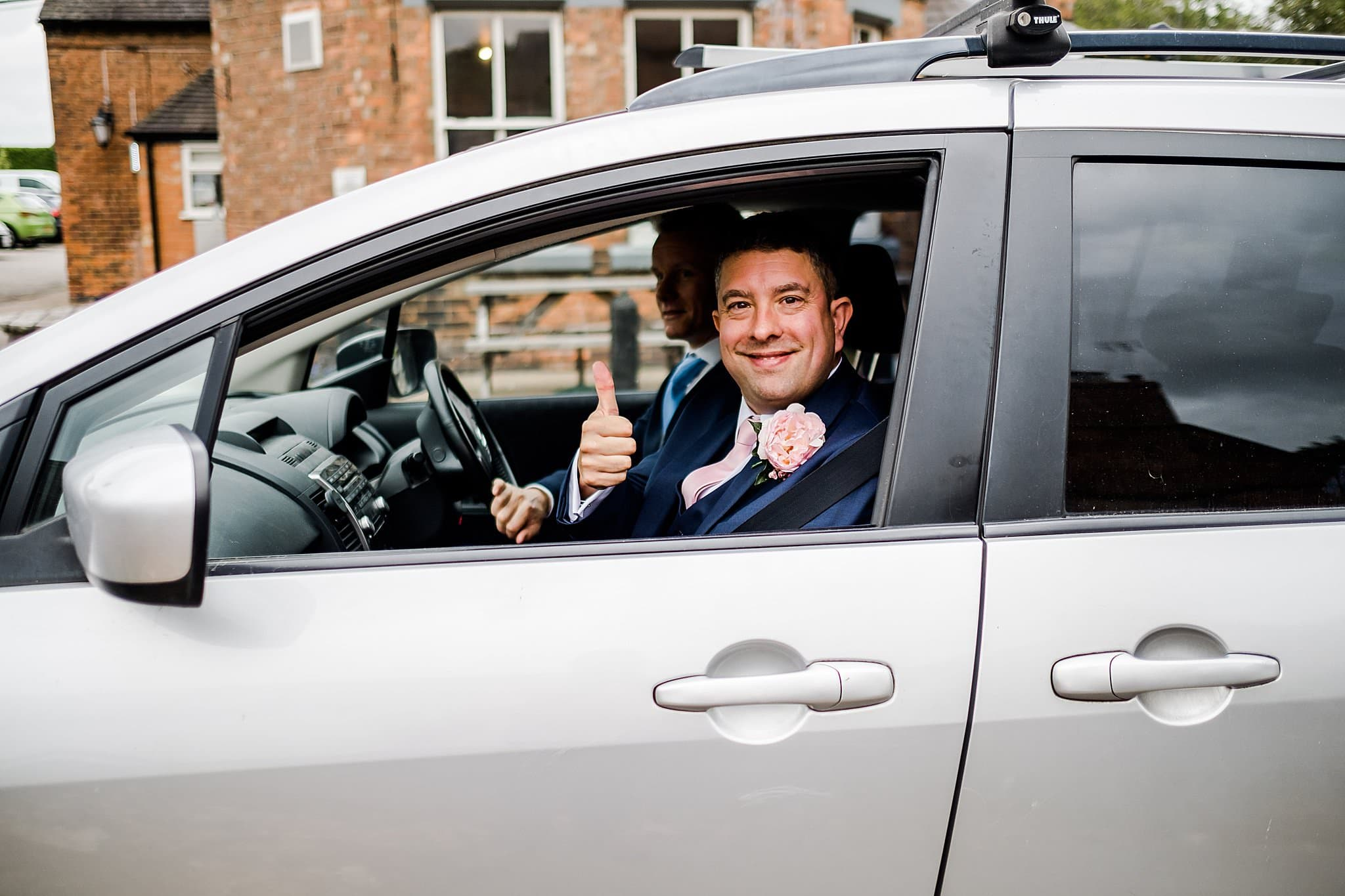 Groom thumbs up on his way to ceremony