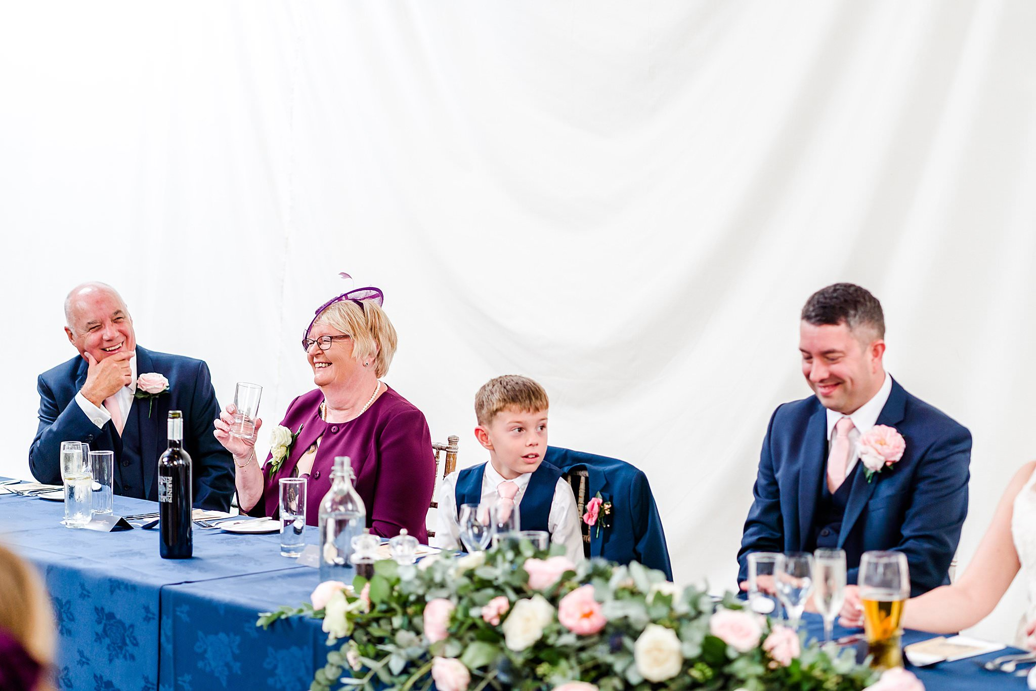 Bride's mum and groom's father enjoy the wedding speech