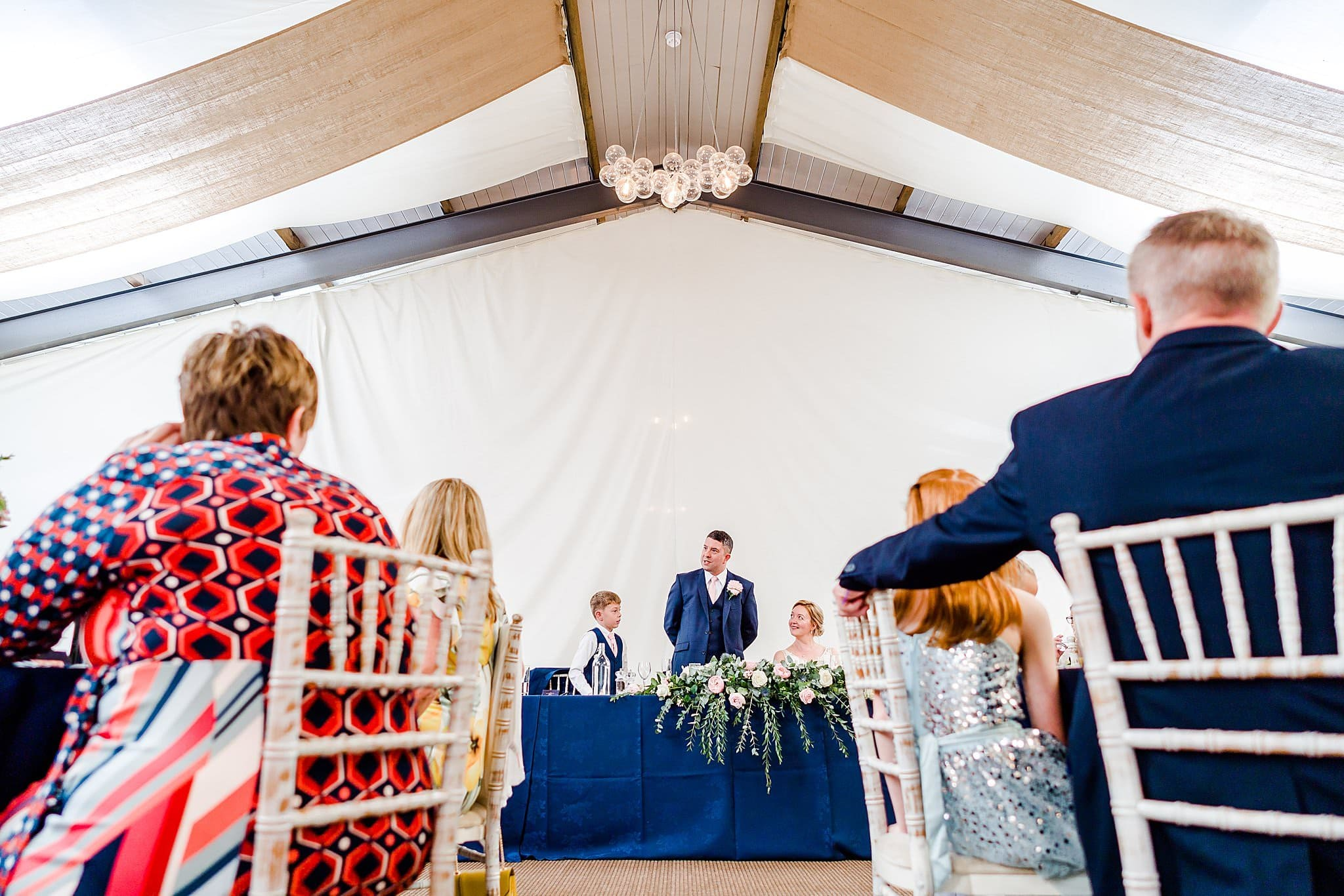 View through the guest of the groom and his son giving a speech at Newton House Barns