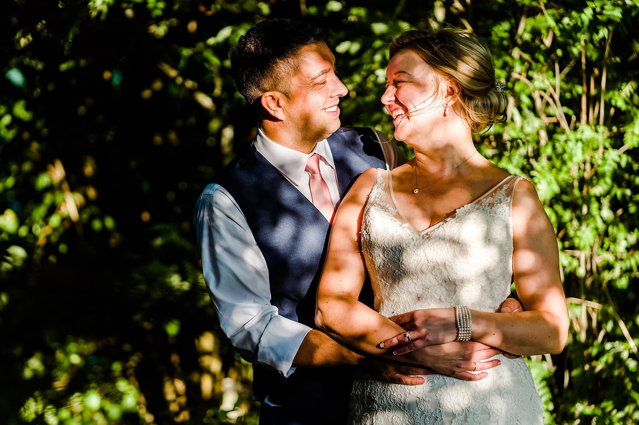 Dabbled light on bride and groom at Newton House Barns
