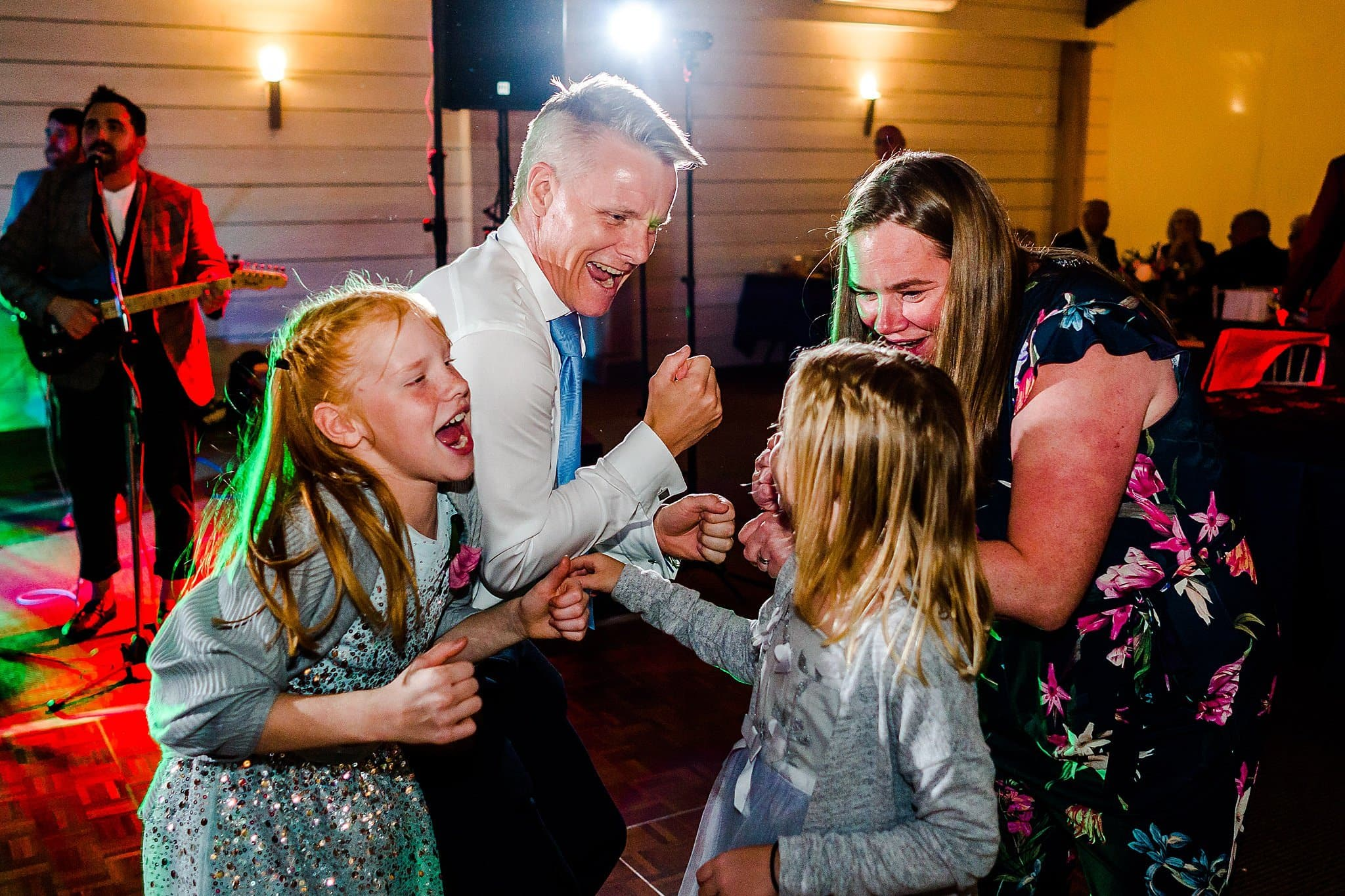 Wedding guest family sing together at Newton House Barns