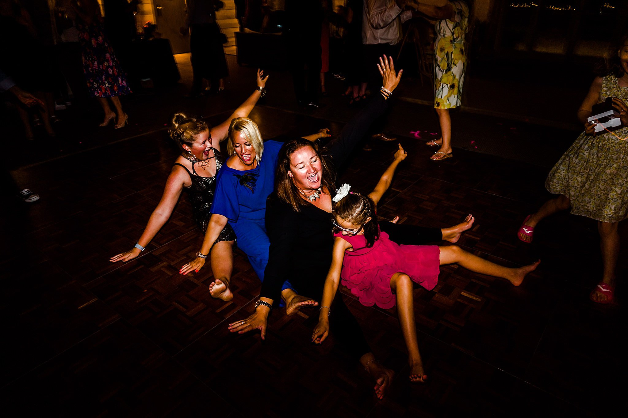 Wedding guests dancing on the floor at Newton House Barns