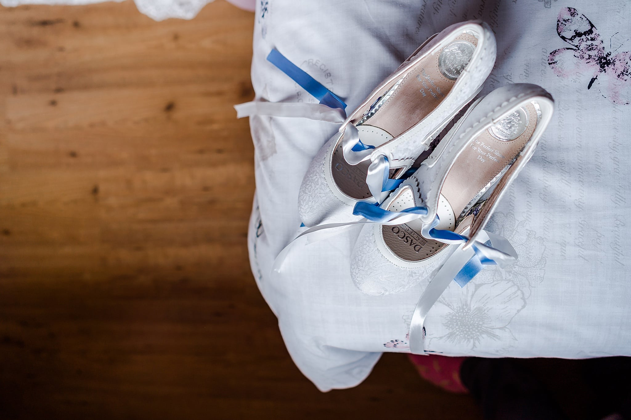 Brides shoes on the corner of bed