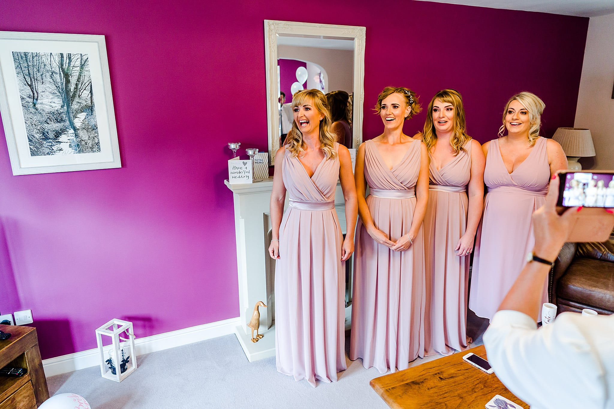 Bridesmaid see bride in her dress for the first time