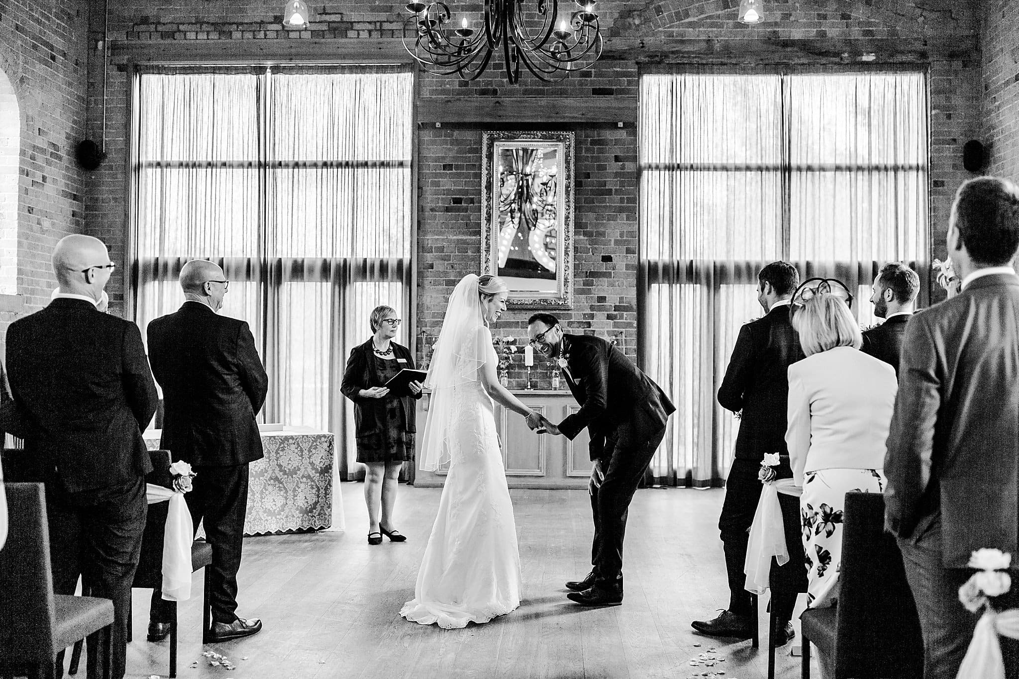 Bride and groom laugh at Carriage Hall