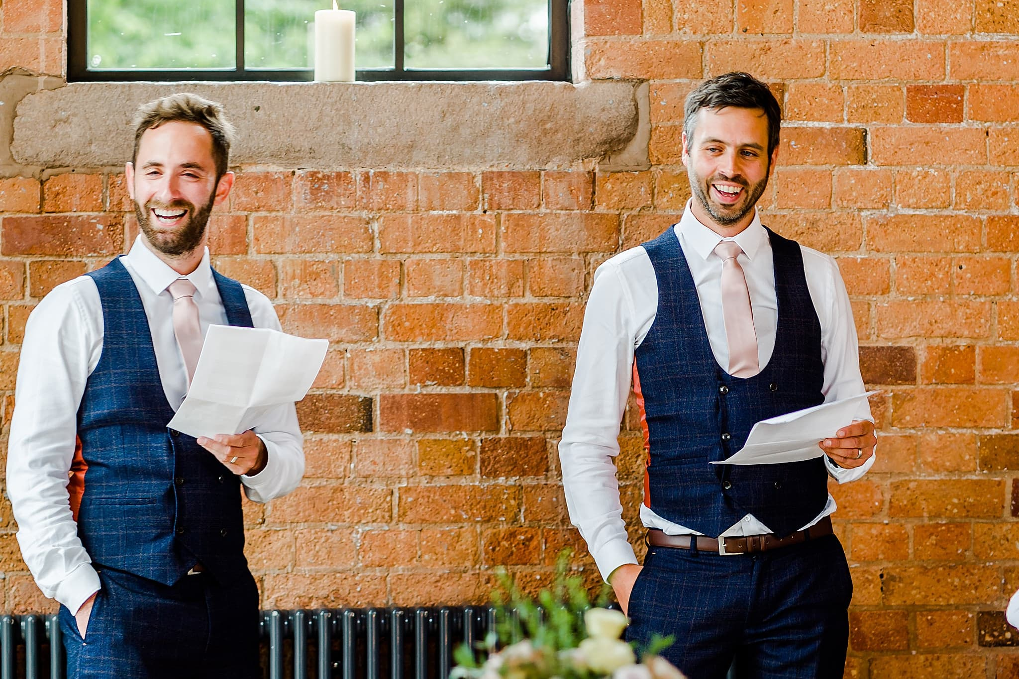 Best men laugh during their speech at Carriage Hall