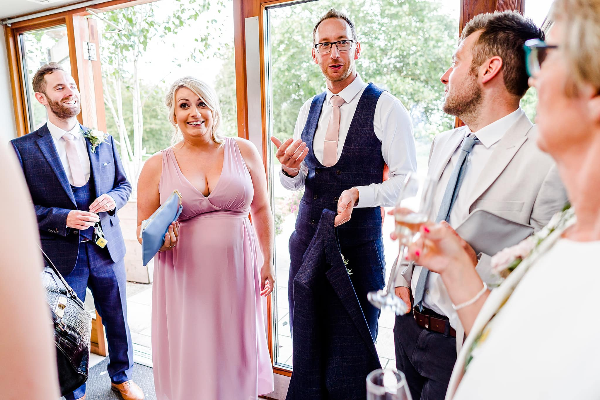 Groom makes a joke about a bridesmaid at Carriage Hall