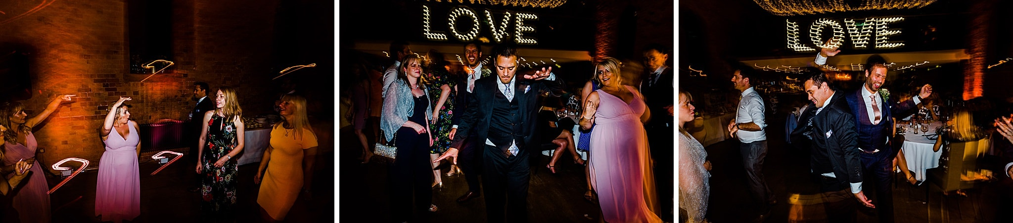 Wedding guests dance on the dance floor at carriage hall