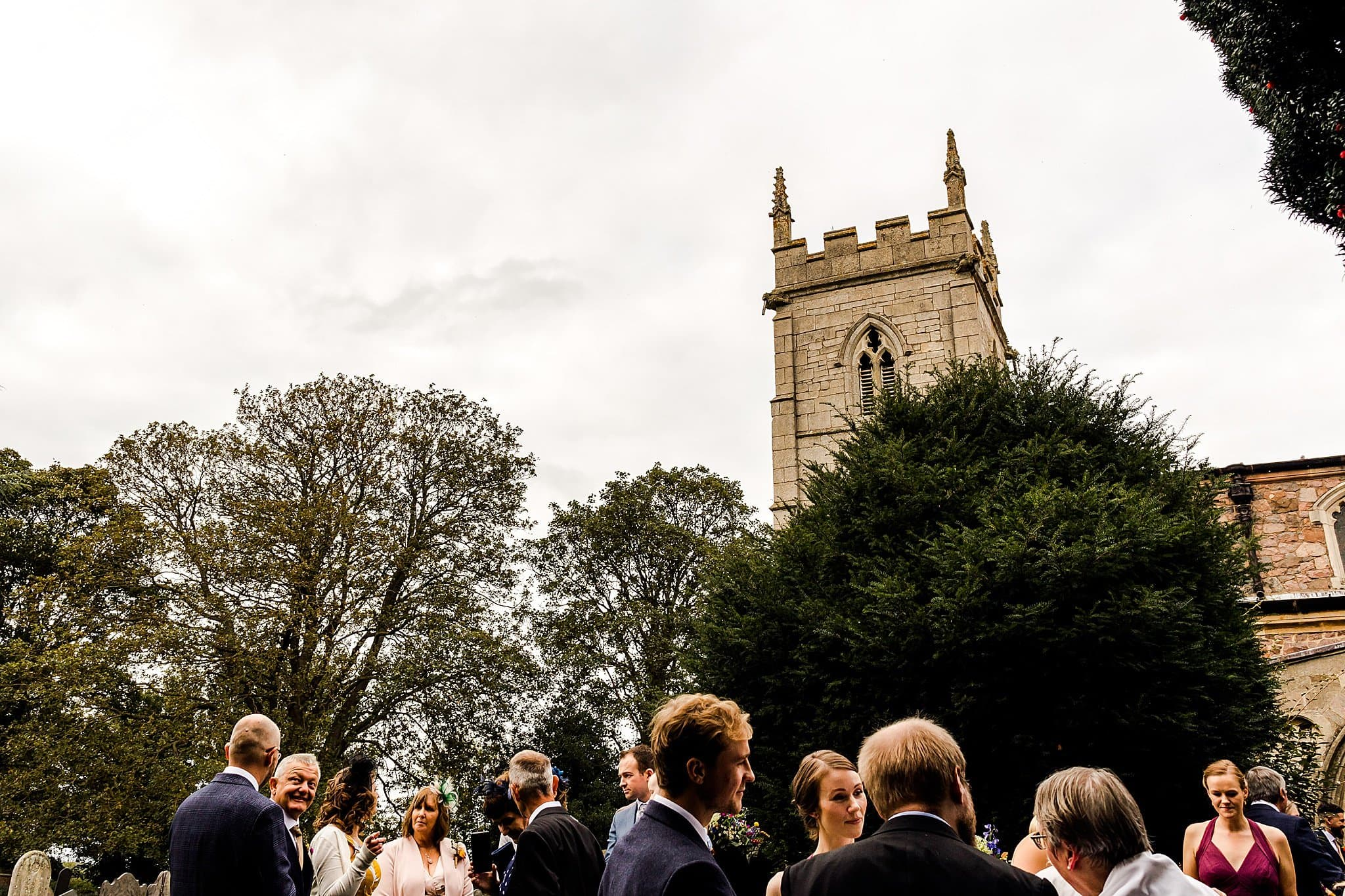 View of the Rearsby Church over the top of wedding guests