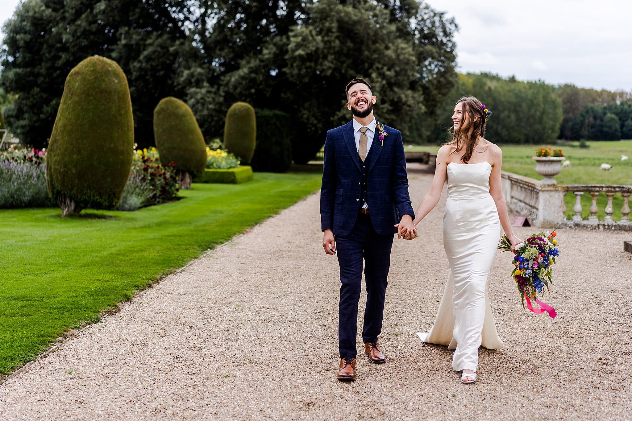 Bride and groom take a walk around the beautiful gardens at Prestwold Hall