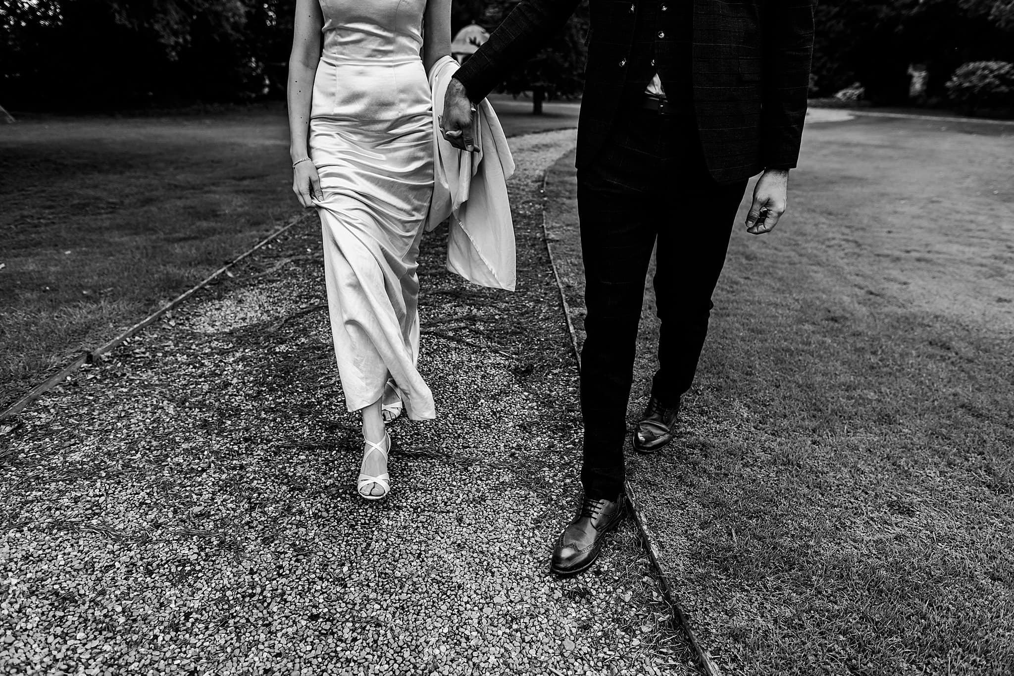 Photos of the bride and grooms shoes as they walk around the grounds at Preswold Hall
