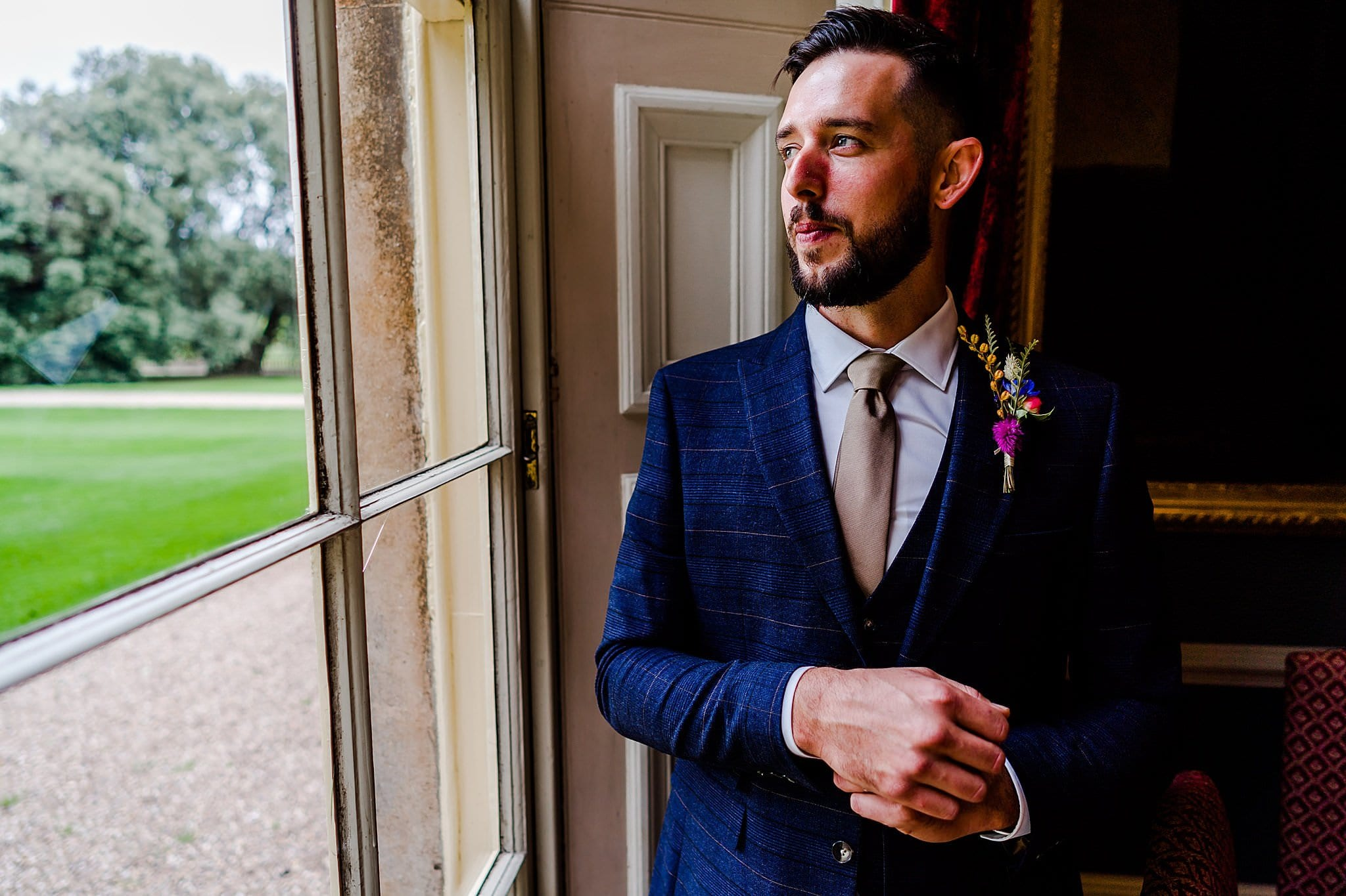 Groom looks out of the window at Prestwold Hall