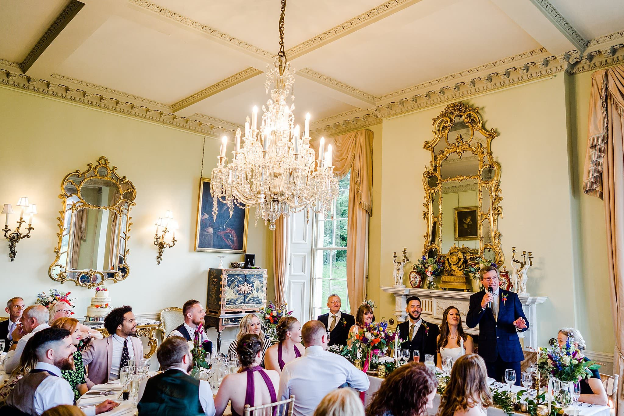 Wide shot of the dining room at Prestwold Hall where the bride's father is giving his speech