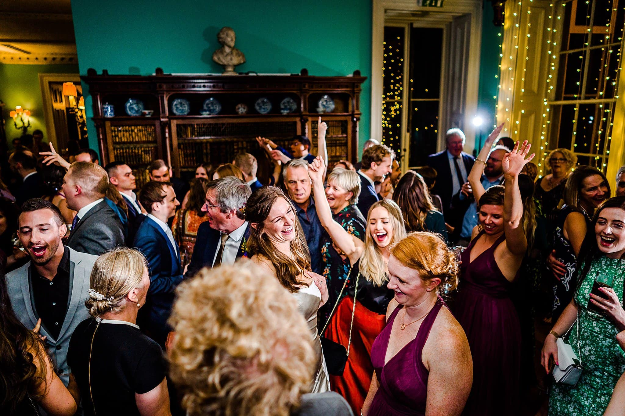 The dancefloor is full of the wedding guests of Sally & Ben at Prestwold Hall