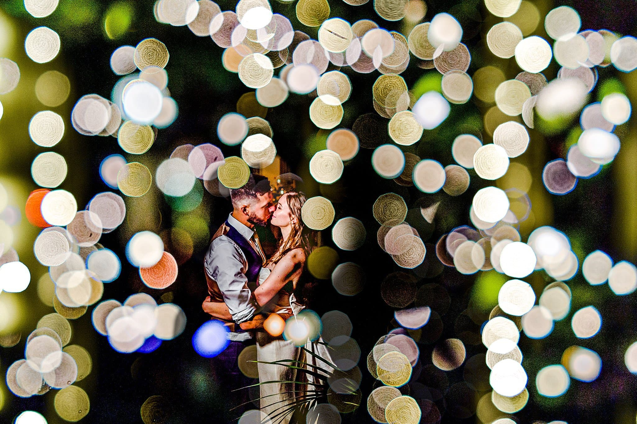 Creative portrait of the bride and groom in the orangery at night at Prestwold Hall